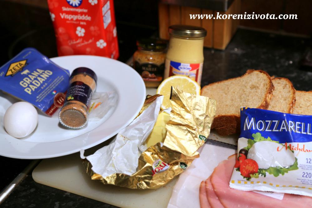 potřebujete toastový chléb, vejce, hořčici, med, muškátový oříšek, smetanu, citronovou šťávu, šunku, mozzarellu, parmezán a zelenou bylinku